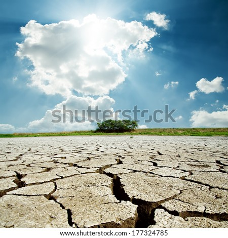 drought earth and sun in cloudy sky - stock photo