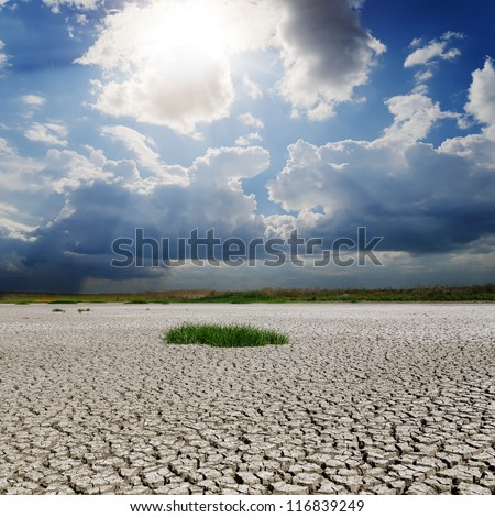drought earth and sun with clouds - stock photo
