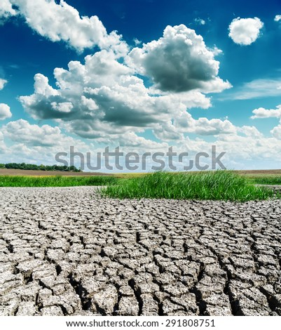 drought earth under dramatic sky - stock photo