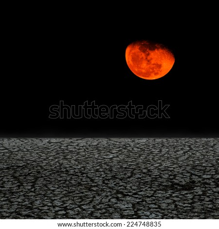 Drought land against dark moon - stock photo