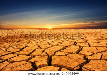Drought land with sunset - stock photo