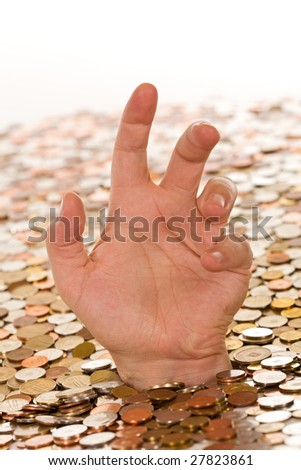 Drowning in debt concept, man hand reaching up from below a layer of coins - stock photo