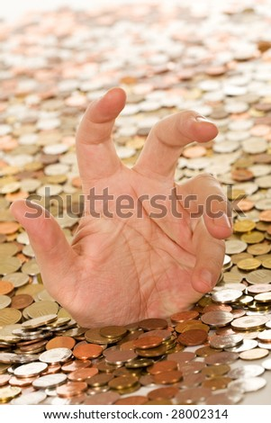 Drowning in debt concept - man hand trying to get a grasp, covered in coins - stock photo