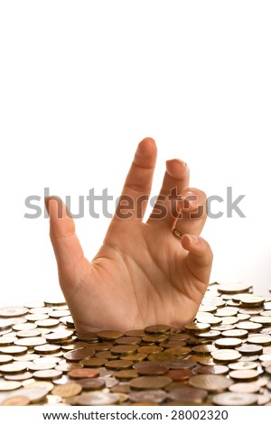 Drowning in debt concept - woman hands reaching up from below coins - stock photo