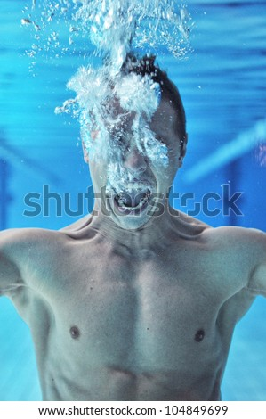 Drowning man underwater diver - stock photo