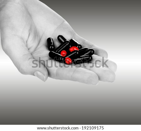 Drug abuse concept - hand holding pills - stock photo