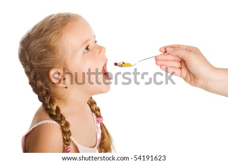 Drug abuse - little girl taking lots of pills with spoon helped by adult hand, isolated