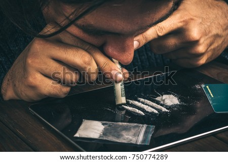 Drug Abuse Hand Man Holds Rolled Stock Photo 571654609
