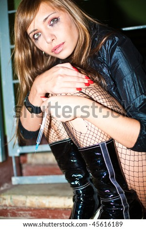 drug addict prostitute young woman with heroin syringe - stock photo