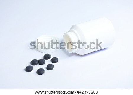 Drug and bottle on white background