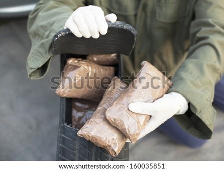 Drug bundles found in spare tire - stock photo