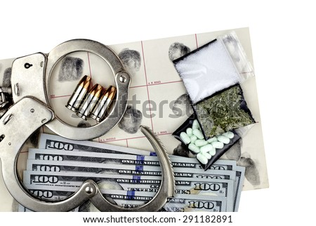 Drug bust arrest with handcuffs, cash, fingerprint ID, and fake sample evidence. - stock photo