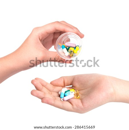 Drug capsules and pills in hand  - stock photo