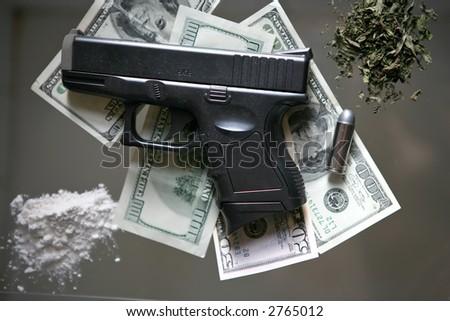 Drug Dealer - gun,money,drug - stock photo