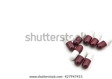 Drug prescription for treatment medication. Pharmaceutical medicament, cure in container for health. Pharmacy theme, Heap of red orange white round capsule pills with medicine antibiotic in packages. - stock photo
