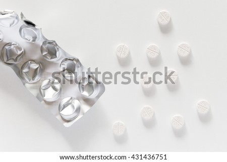 Drug prescription for treatment medication. Pharmaceutical medicament, cure in container for health. Pharmacy theme, Heap of  white round capsule pills with medicine antibiotic in packages. - stock photo