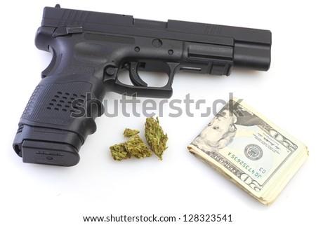 Drug Trade Wealth/Handgun, marijuana buds & US currency against white background - stock photo