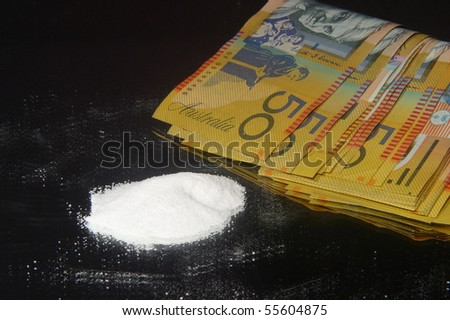 Drugs and fifty dollar notes - stock photo