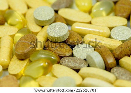 Drugs and food supplements pills and capsules macro background include  Fish oil pills. Drug Capsule.Vitamin pills.Vitamin capsules - stock photo