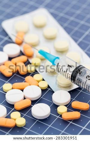 Drugs and injection syringe - stock photo