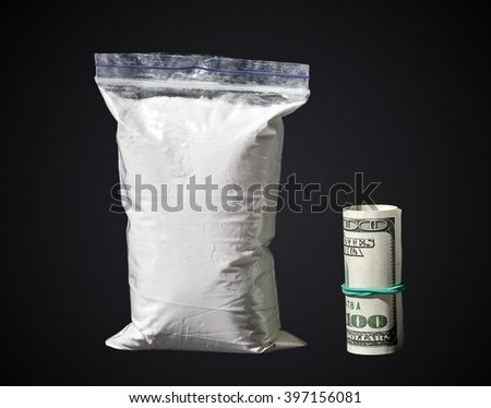 drugs, cocaine with money isolated on a black background - stock photo