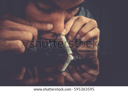 Drugs concept. Closeup picture of drug addict using drugs. Drug addict man alone.