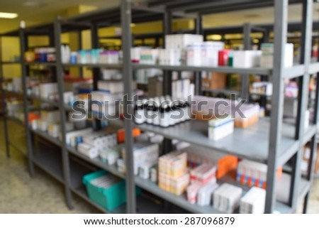 Drugs in the pharmacy. Shelves stocks in the warehouse of drugs. Blurred background. - stock photo