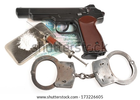 Drugs, syringe with blood, pistol, handcuffs and money isolated - stock photo