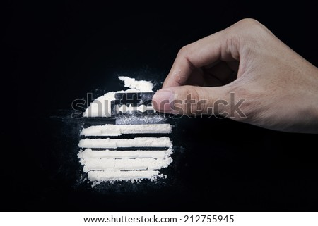 Drugs user preparing drugs to used with razor blade - stock photo