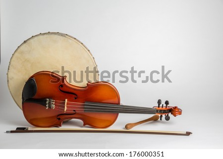 Drum and Fiddle. A Irish drum  (bodhran) and a viola on a white background - stock photo