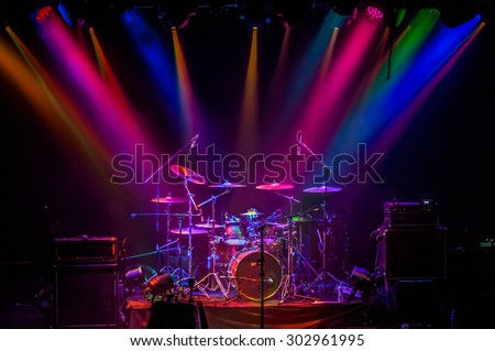 Drum kit on stage in the spotlight color - stock photo