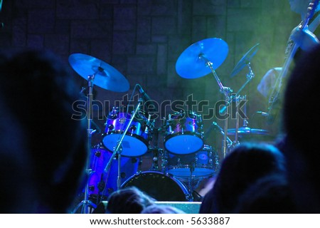 Drum set on the stage. Live concert of popular rock band. - stock photo