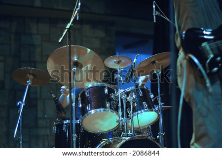 Drum set on the stage while band playing - stock photo