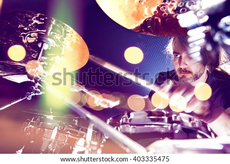 Drummer and live music concept background. Drum and live music. Stage lights concert - stock photo