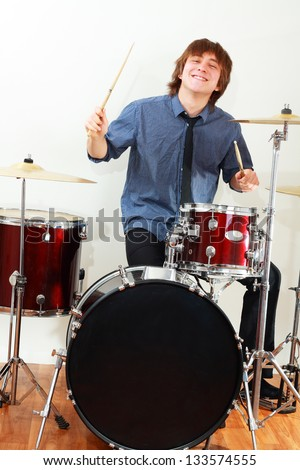 drummer man playing on drums studio shot - stock photo