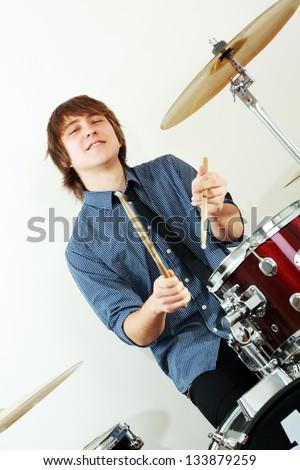 drummer man playing on drums studio shot - stock photo
