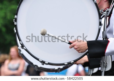 Drummer Playing A Bass Drum in Parade - stock photo