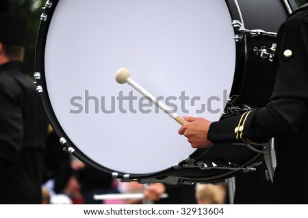 Drummer Playing Bass Drum in Parade, Copy Space - stock photo