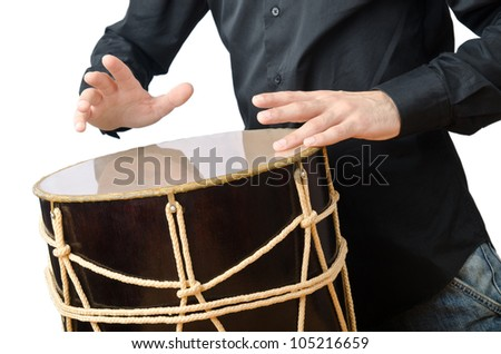 Drummer with drum playing on white - stock photo