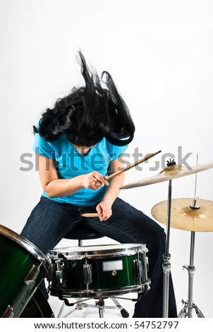 Drummer woman flipping hair feeling the music and play drum kit - stock photo