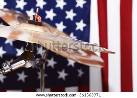 drums, cymbals, against the backdrop of the American flag