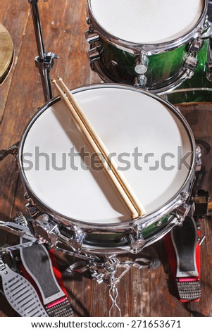 Drumsticks are on the drum set top view - stock photo
