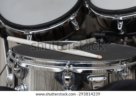 drumsticks closeup lying on the drum set - stock photo