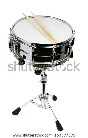 Drumsticks resting on a well-worn metal snare drum. - stock photo