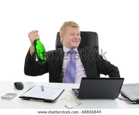 Drunk businessman drinking champagne on the job in the office. Isolated on white background