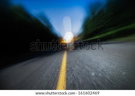 Drunk Driving, Speeding, Being too Tired to Drive are Potential Concepts for This Image of Blurry Road at Night - stock photo