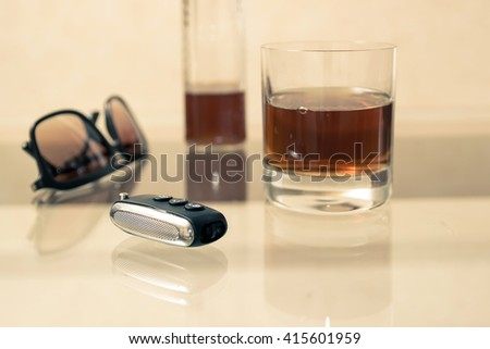 Drunk driving - the cause of car accidents. Drink driving. Sunglasses and keys. - stock photo
