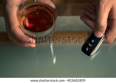 Drunk driving - the cause of car accidents. Drink, keys  - stock photo