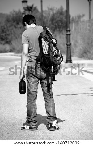 Drunk guy strolling around a lonely street - stock photo
