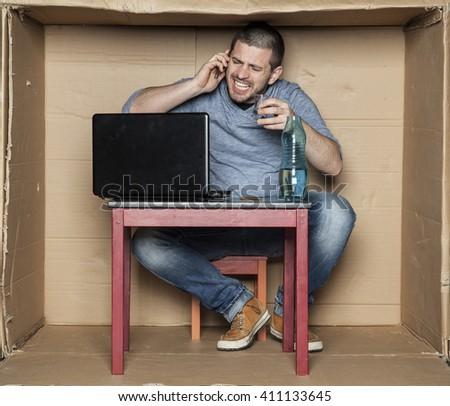 drunk intern talking on the phone - stock photo